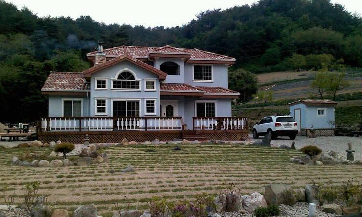 울진 덕구 프로젝트: (주)트라움목조주택의  주택,