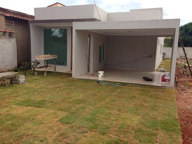 排屋 by Rudini Rodarte Arquitetura e Construção