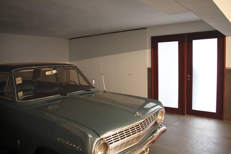 Garage/shed by GRAU.ZERO Arquitectura, Modern