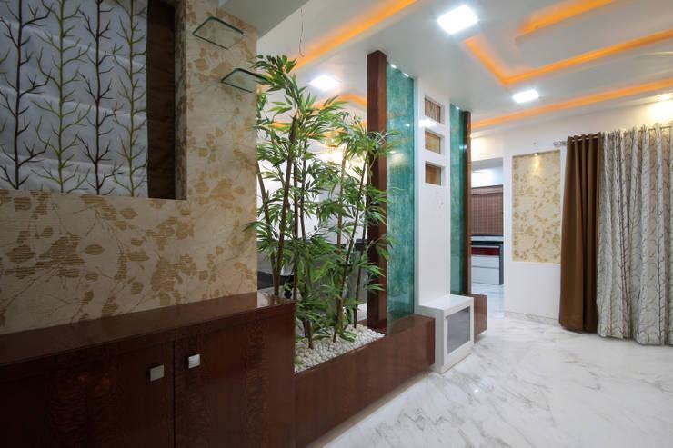 Residence -  Mr. Mane, Pune.:  Living room by Spaceefixs