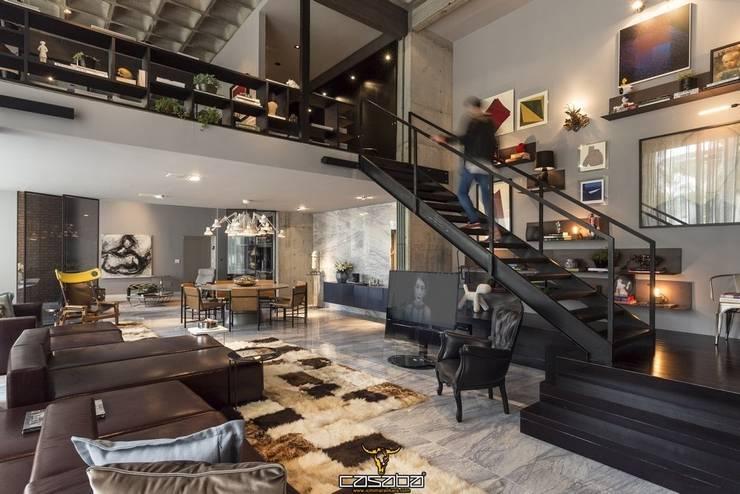 modern Living room by CASABA