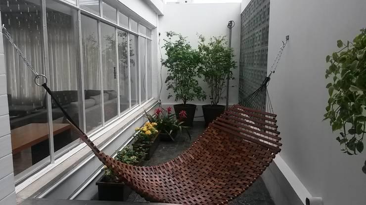 Área Externa: Terraços  por Flavia Tonacci Arquitetura