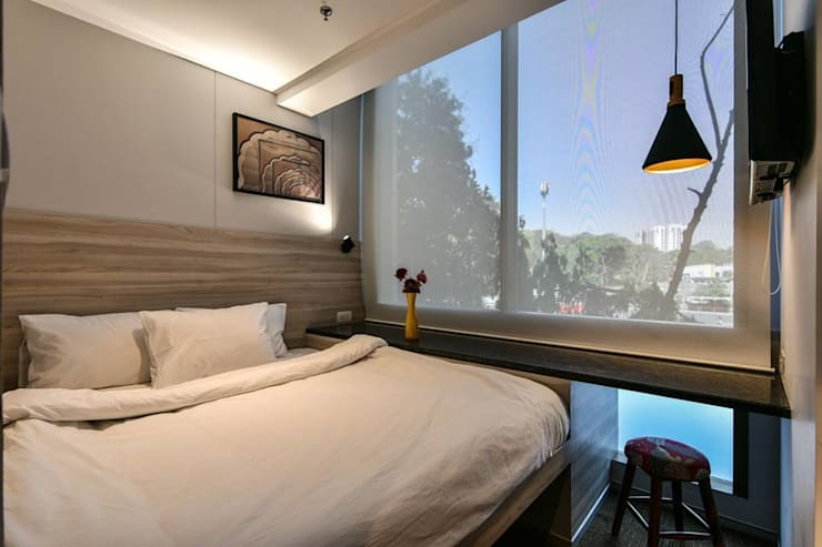 Suit:  Hotels by Racheta Interiors Pvt Limited,Modern