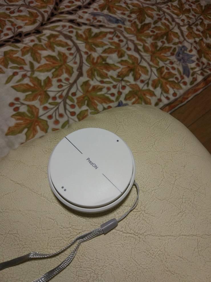 ปุ่มกด สวิตช์ไฟไร้สาย เพรซออน:  ห้องนั่งเล่น by บริษัท เพรซออน เทคโนโลยี จำกัด