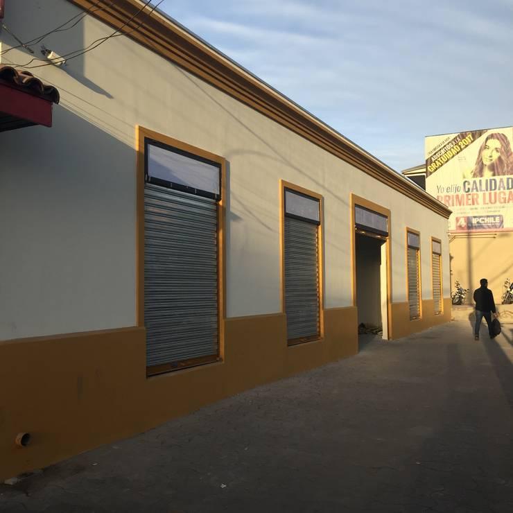 Fachada:  de estilo  por Área Urbana Arquitectos SpA