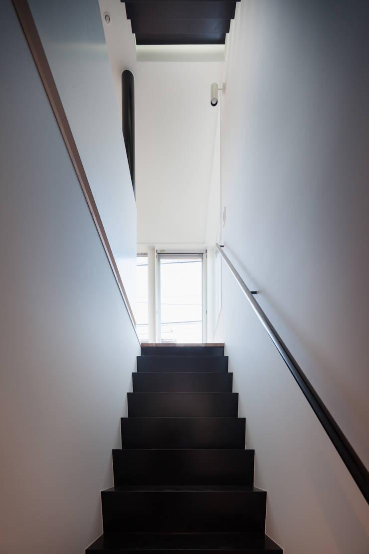 階段: 有限会社角倉剛建築設計事務所が手掛けた階段です。,