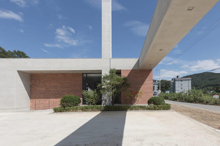 Palacios de congresos de estilo  de 오종상 건축사