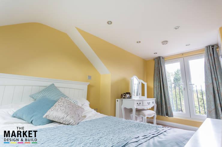 THE AMERSHAM LOFT AND GARAGE CONVERSION: modern Bedroom by The Market Design & Build