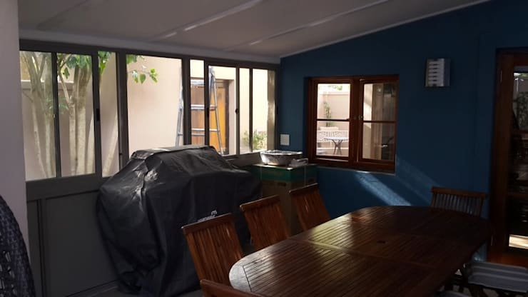 Built in Wooden Sliding Doors, Slab Cast And Tiled Patio, Aluminium And Glass Conservatory, Exterior House Painted, Aggregate Driveway Layed.:   by CPT Painters / Painting Contractors in Cape Town