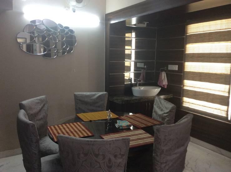 Interior Ozal-Dinning Room:  Dining room by InteriorOzal