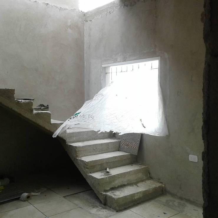 e. gonnet: Casas unifamiliares de estilo  por dc estudio,Minimalista Hormigón