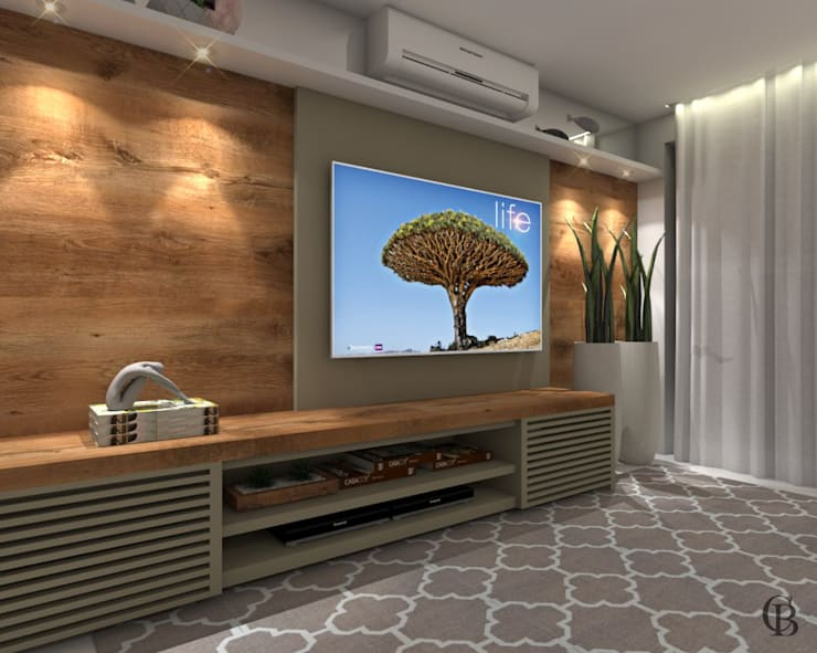 Vista Lateral l Sala de Televisão: Salas multimídia  por Caroline Berto Arquitetura