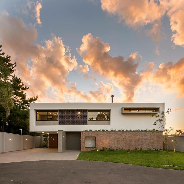 Casas de estilo  por Guaraúna Revestimentos