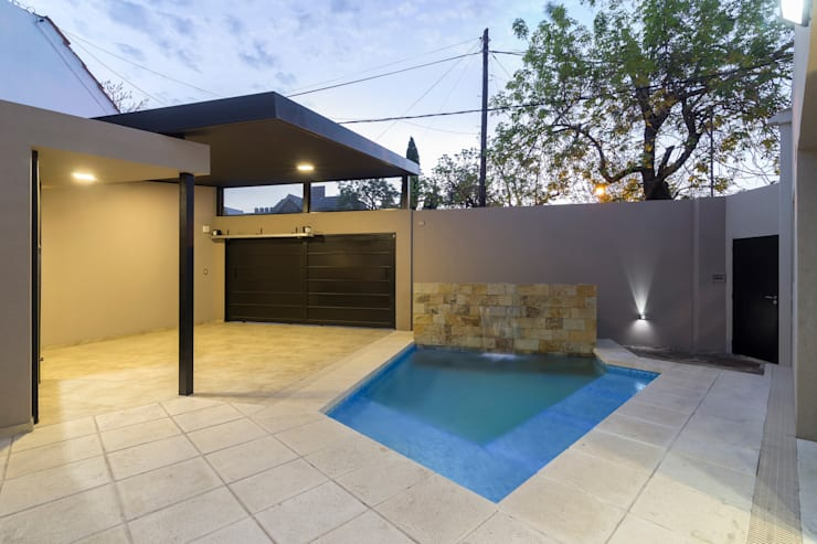 Casa 2C - REFORMA y AMPLIACIÓN : Piletas de estilo  por D'ODORICO OFICINA DE ARQUITECTURA