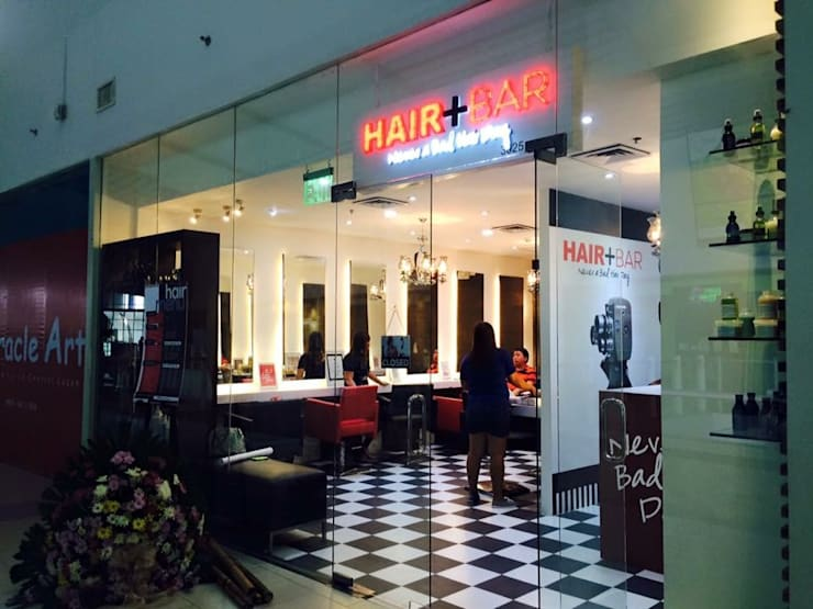 Hair + Bar salon:   by GK + BAM Architects