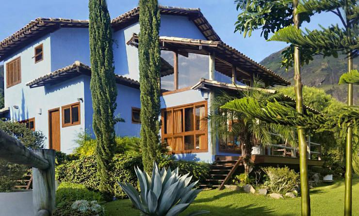 Casas de estilo rural por Cláudio Maurício e Paulo Henrique