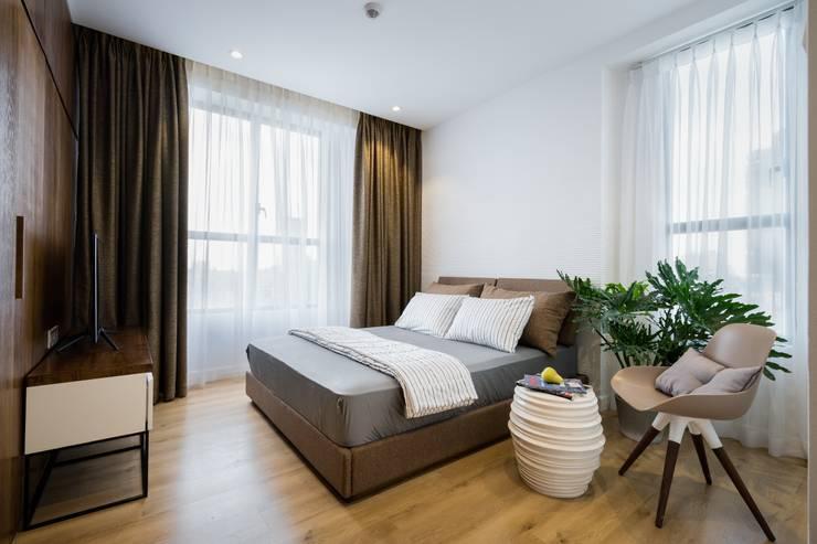 Bản thân không gian kiến trúc tương tác chặt chẽ với người sử dụng.:  Phòng ngủ by Công ty TNHH Thiết Kế Xây Dựng Song Phát