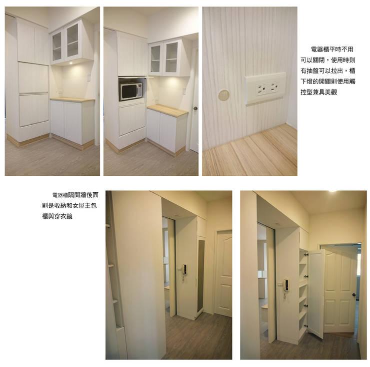 Living room by 樂乙設計