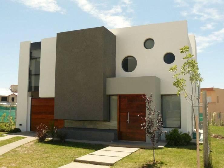 Casas unifamiliares de estilo  por Estudio A+I