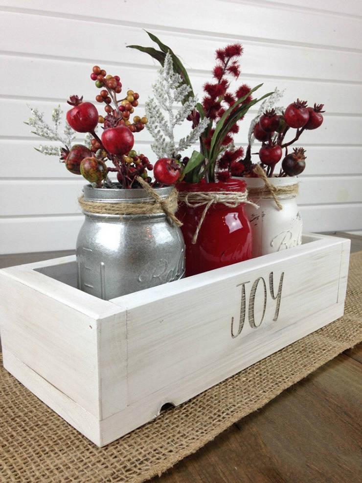Sử dụng các loại quả màu đỏ khác để thay cho hoa nếu muốn.:  Nhà gia đình by Công ty TNHH Thiết Kế Xây Dựng Song Phát