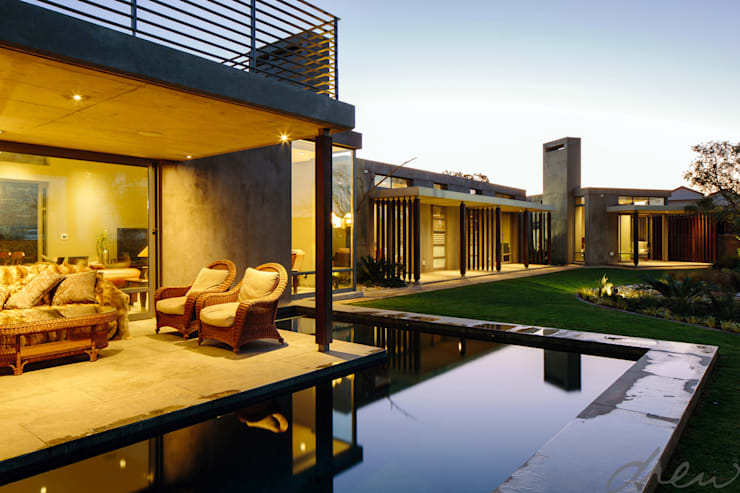 spine wall house:  Patios by drew architects + interiors