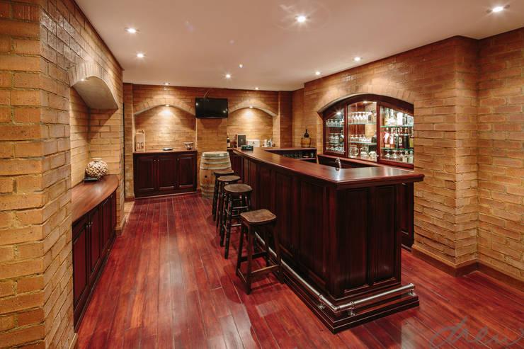city skyline farmhouse:  Wine cellar by drew architects + interiors, Classic Bricks