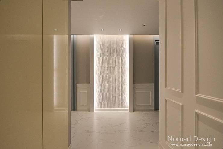 66평 강서구 엘크루블루오션 – 부산: 노마드디자인 / Nomad design의  벽