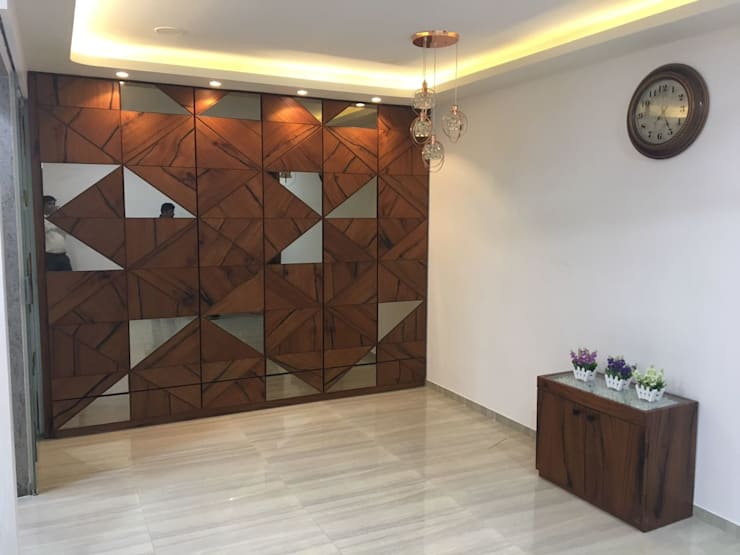 Utility storage unit :  Living room by Vinayak Interior | Interior Designing and Decorator Companies