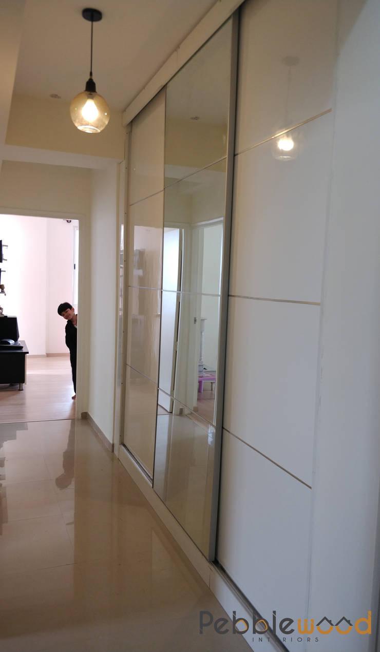 B6111—DLF Westend Heights: modern Bedroom by Pebblewood.in