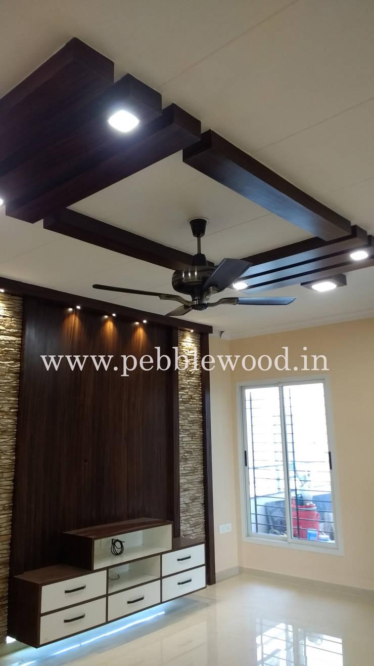 Nandi Citadel - E303:  Living room by Pebblewood.in