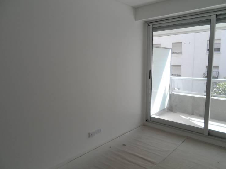 Monoambiente. dormitorio-estar: Dormitorios de estilo  por NG Estudio,Moderno Caliza