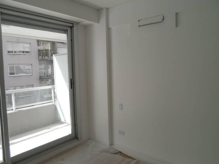 Monoambiente. dormitorio-estar: Comedores de estilo  por NG Estudio,Moderno Cerámico