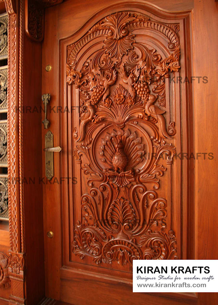 Carved Main Door:  Wooden doors by Kiran Enterprises