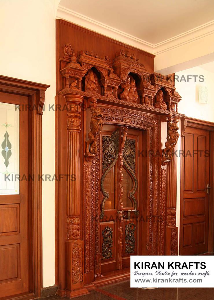 Carved Pooja Door:  Wooden doors by Kiran Enterprises
