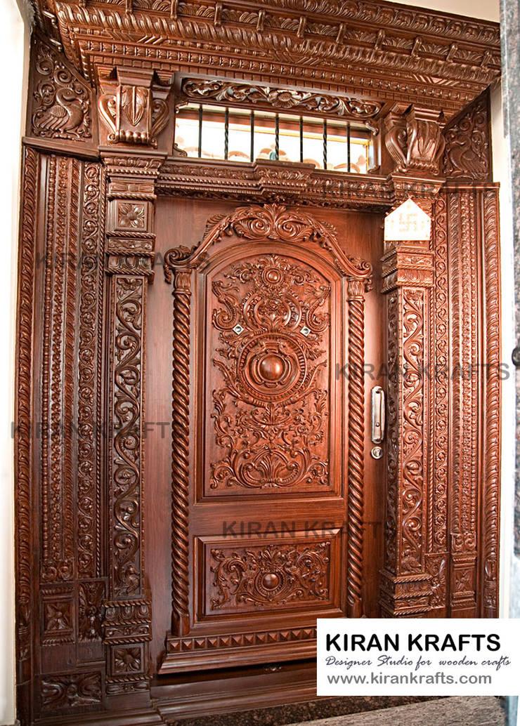 Main Door:  Wooden doors by Kiran Enterprises