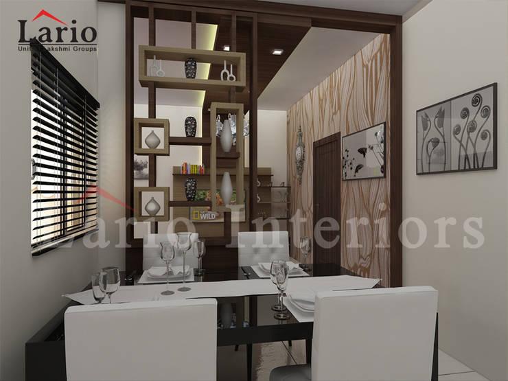 Crockery unit:  Living room by Lario interiors