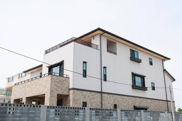 2X4框組壁工法住宅:  房子 by 台日國際住宅股份有限公司