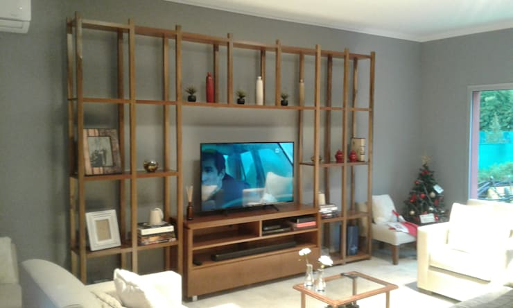 Mueble para TV + biblioteca en petiribí: Livings de estilo  por Nestorcahu
