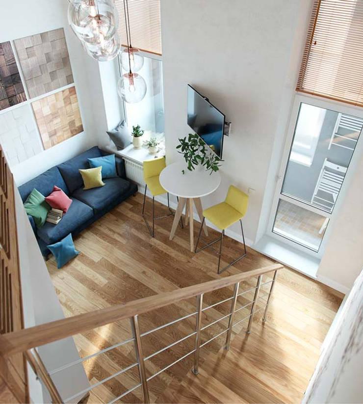 Gác lửng có chức năng tạo không gian sinh hoạt hàng ngày.:  Phòng khách by Công ty TNHH Thiết Kế Xây Dựng Song Phát