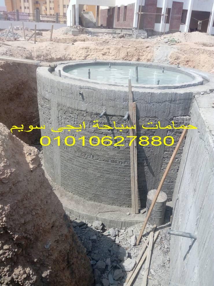 حمام سباحة اوفرفلو بمدينة اسيوط الجديدة:  حديقة تنفيذ حمامات سباحة ايجي سويم