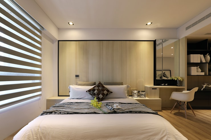 Dormitorios de estilo  por 喬克諾空間設計