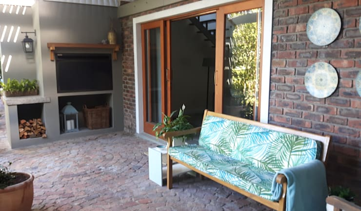 Braai area:   by Bibby Interior Design