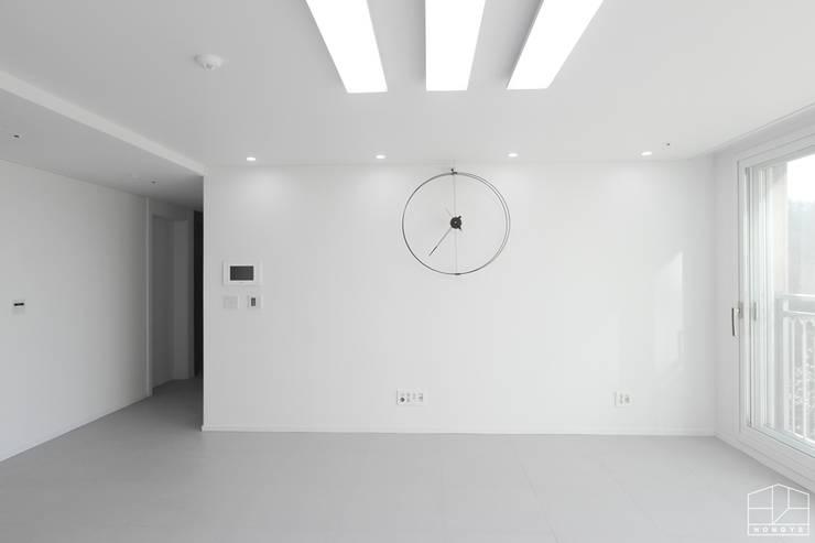 깨끗하고 모던한 분위기의 46평 아파트 인테리어: 홍예디자인의  거실,