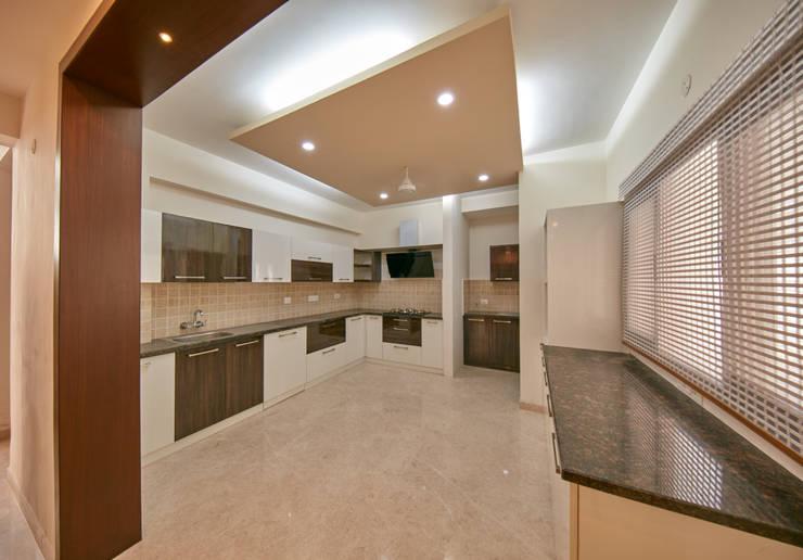 false ceiling inside kitchen : modern Kitchen by NVT Quality Build solution