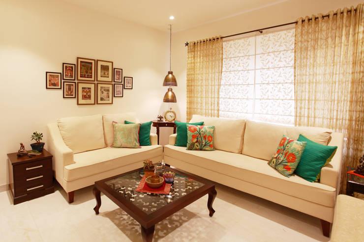 Lotus Apartment:  Living room by Saloni Narayankar Interiors