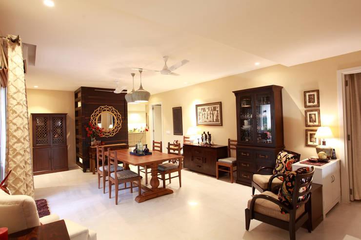 Lotus Apartment:  Dining room by Saloni Narayankar Interiors