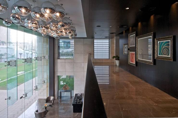 Lodha Bellissimo Clubhouse:  Corridor & hallway by Racheta Interiors Pvt Limited