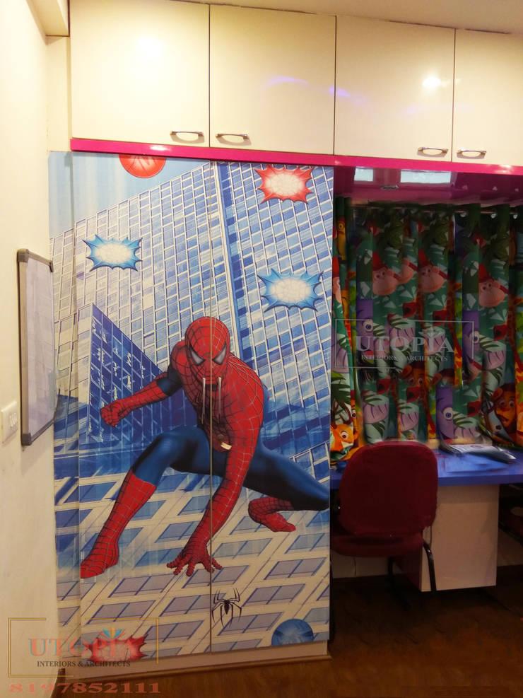 Kid's room wardrobe:  Nursery/kid's room by Utopia Interiors & Architect,Modern