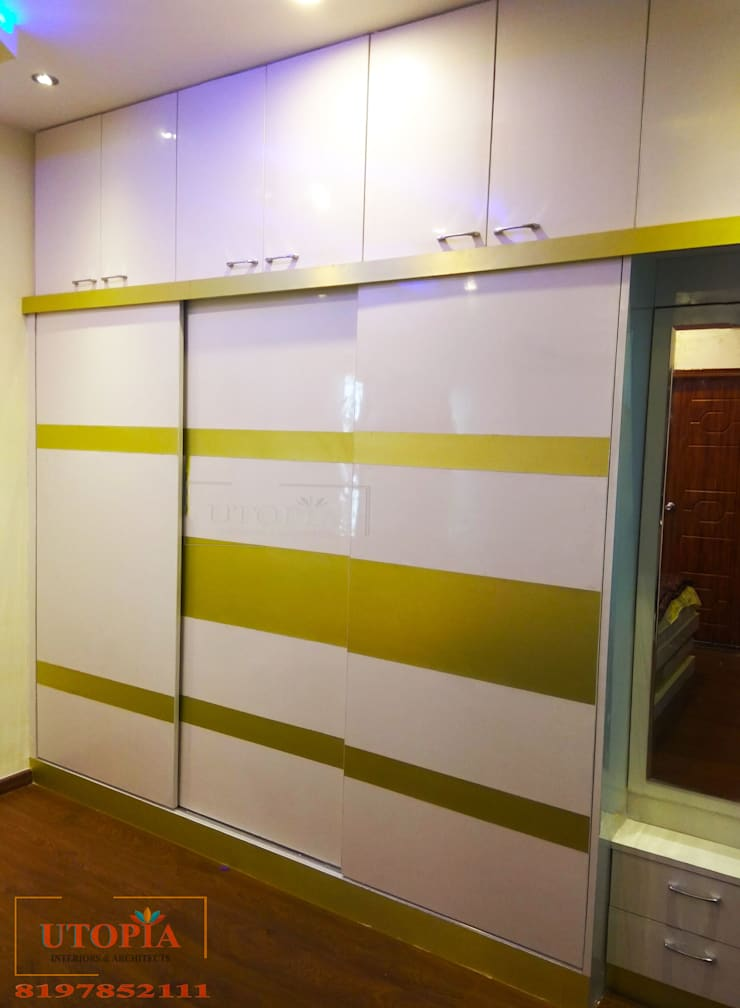 Wardrobe design:  Bedroom by Utopia Interiors & Architect,Modern
