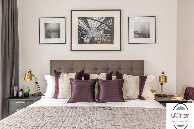 Attico a Bologna: Camera da letto in stile in stile Moderno di GIOInterni